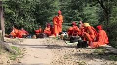 Poor Tibetan men begging money on the road in the Dharamsala, India Stock Footage