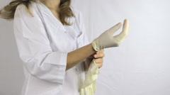 Nurse hand put sterile medical glove, stand sideways Stock Footage
