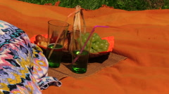Glass with bubble champagne drink and woman eating grapes Stock Footage