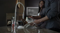 Attractive couple doing dishes together Stock Footage