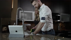 Young Couple Doing Dishes Together in Home Stock Footage