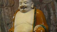 A buddha like statue of a bald man Stock Footage