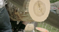 The sawing of a big log from a competition Stock Footage