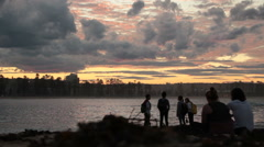 Friends hang out at sunset Stock Footage