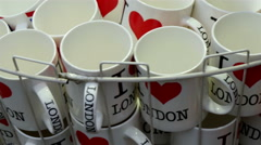 Mugs and coffee cups with I Love London drawing Stock Footage