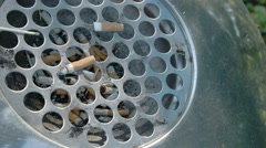 Cigarette ashtray on the street Stock Footage