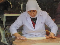 Woman Turkey rolling flatbread in Istanbul Turkey Stock Footage