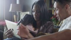 Attractive Couple Using Tablet Computer for Surfing the Web Stock Footage