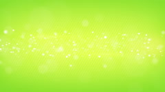 Glowing bokeh circles green loop background shallow DOF Stock Footage