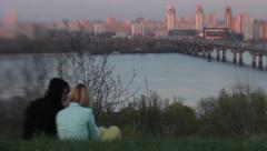 Dating young couple on the river in the evening. Romance, Dating, love - stock footage