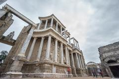 The Roman Theatre in Merida with blurred tourists - stock photo