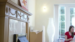4K Happy young couple unpacking boxes, moving into new home - stock footage