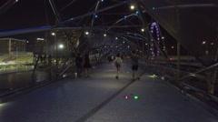 POV. Walking on helix bridge at night, steadycam shot, Singapore. Stock Footage