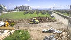 Road construction work. High angle at yellow roller and bulldoze Stock Footage