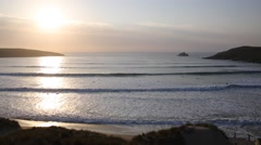 Sunset in Cornwall surfers surfing in spring evening Stock Footage