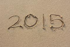 "Stock Photo of the inscriptions ""2015"" on sand beach"