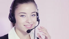 Attractive professional woman with headset - stock footage