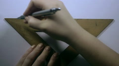 Girl's hand draws the grey line Stock Footage