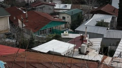 CRIMEA. APRIL 2011: Roofs of the old houses Stock Footage
