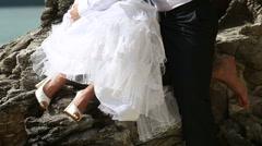 brunette bride hugs and kisses handsome groom - stock footage