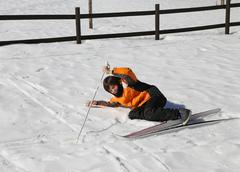 Inexperienced boy trying for the first time the cross-country skiing Stock Photos