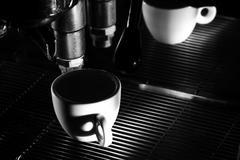 Espresso machine brewing a coffee. Black and white photo - stock photo