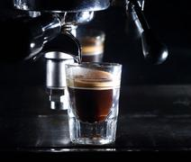 Espresso machine brewing a coffee Stock Photos
