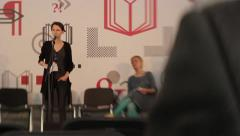 Poetry readings. Girl-poet performs on stage. Literature, prose, novel, poetry - stock footage