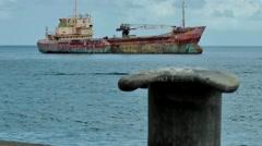 Grenada island Caribbean Sea 004 old rusty ship wreck at anchor Stock Footage
