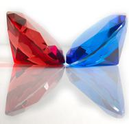 Red and Blue Faceted Gemstones Stock Photos