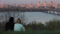 Date a guy and girls in the evening at sunset near river. Romance, Dating, love - stock footage