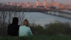 A girl and a guy on a date by the river at sunset. Romance, Dating, love - stock footage