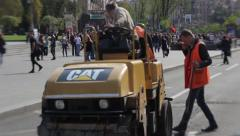 Road workers repairing the main street of Kiev - Khreschatyk Stock Footage