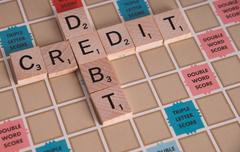 Credit Debit Scrabble Concept Stock Photos