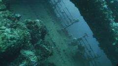 Underwater shot of sunken ship wreck, wreck aside Stock Footage
