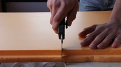 The man cuts the knife polystyrene sheet Stock Footage
