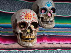 Day of the Dead (dia de los muertos) decorated skulls with colorful Mexican blan Stock Photos