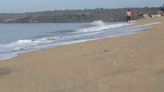 Man running at sandy beach in Goa. Stock Footage