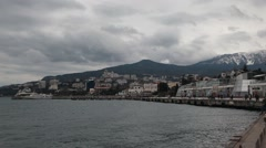 CRIMEA. JANUARY 2011: View of the Yalta embankment. in the background the city. Stock Footage