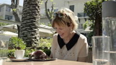 Woman With  IPad In The Street Cafe Stock Footage