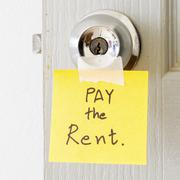 Stock Photo of sticky note write a message pay the rent