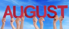 Hands Holding Red Straight Word August Blue Sky Stock Photos