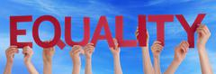 Hands Holding Red Straight Word Equality Blue Sky Stock Photos