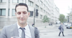 4K Cheerful young professional man making mobile phone call in the city Stock Footage
