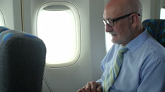 Man travels with laptop on airplane Stock Footage