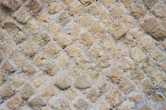 Antique roman stone wall background - stock photo