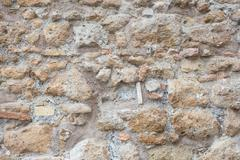 Antique roman stone wall background Stock Photos