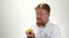 Man Eating Organic Apple Stock Footage