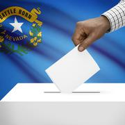 Stock Illustration of Voting concept - Ballot box with US state flag on background - Nevada