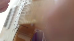 SLOW MOTION: guitar strings rack focus Stock Footage